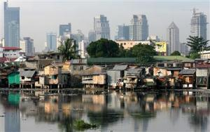 Background: Makati skyline; foreground: slums by the Pasig River