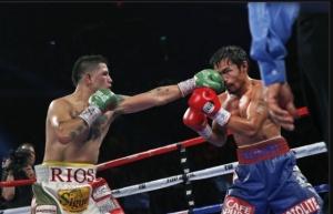 American Brandon Rios punches Filipino Congressman Manny Pacquiao