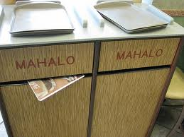 "Trash bins at a Waikiki restaurant marked ""Mahalo"""