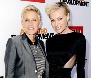 DeGeneres, left , with spouse de Rossi