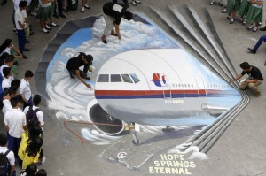 Students watch as artists finish a school-ground painting inspired by the missing Malaysia Airlines plane in the Philippine city of Makati.  (Photo: Romeo Ranoco/Reuters)