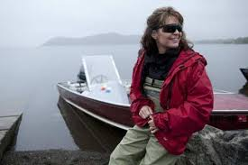Palin in her backyard.  Russia is seen in the background