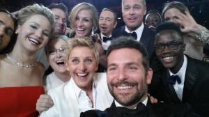 Bradley Cooper, foreground, takes the photo that went viral on Oscar night