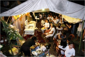 A typical Filipino wake, with lots of food, singing, drinking and gambling.