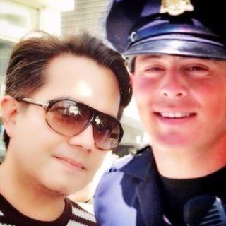 San Francisco Filipino American designer Michael Bello with the 'Hot Cop of Castro'  (Photo courtesy of Bello's selfie)