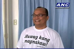 Fr. Fajardo wearing t-shirt that says, 'Thou Shall Not Steal'