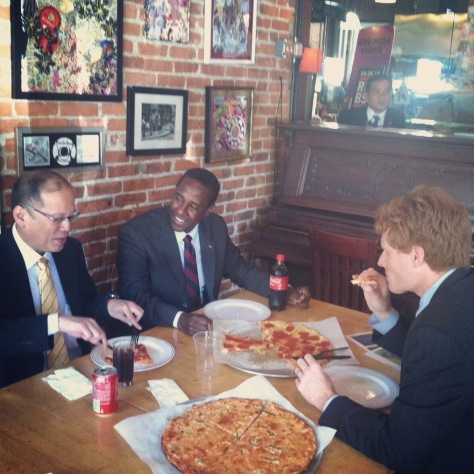 Aquino with Kennedy, right, and Mayor Setti Warren of Newton