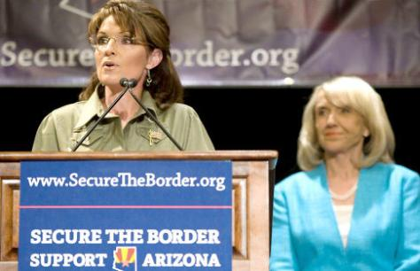 File Photo:  Sarah Palin at an anti-immigration forum in Arizona, with Governor Jan Brewer