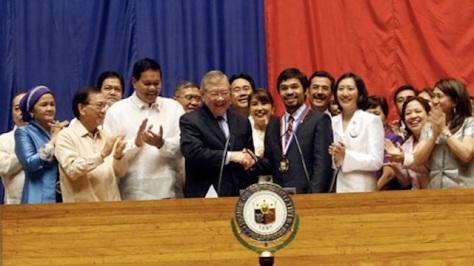 Member of Philippine Congress with Pacquiao (Photo: www.rapler.com)