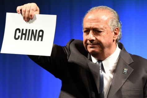 FIBA (International Basketball Federation) president Horacio Muratore from Argentina announces China as the host country of the 2019 FIBA Basketball World Cup during a ceremony in Tokyo on August 7, 2015. China has won the right to host the 2019 basketball World Cup, beating out the Philippines in a vote on August 7 in Tokyo.  AFP PHOTO / TOSHIFUMI KITAMURA