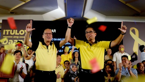 "Aquino, left, and Roxas, during the ""anointing"" ceremonies in Manila this week (Photo: rapler.com)"