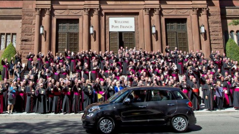 U.S. bishops welcome Pope Francis in Washington, D.C., as he alights from a tiny Fiat
