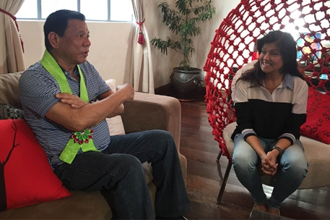 Duterte, left, meets with Ilocos Governor Imee Marcos