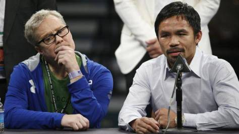 Pacquiao, right, with his coach Freddie Roach